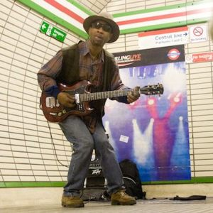 A busker at London's Tottenham Court Road underground station