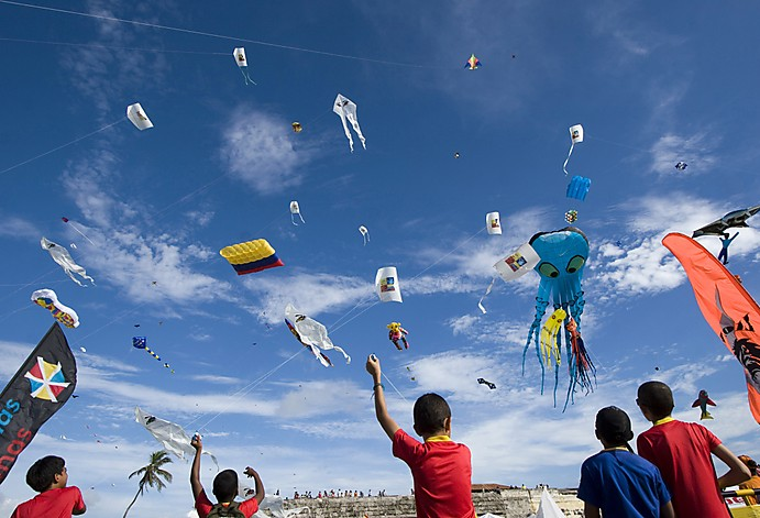 Children fly kites during an international kite festival in Cartagena